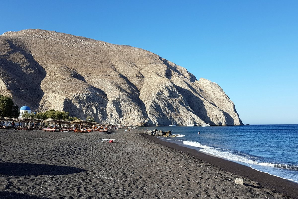 Perivolos or Perissa beach is the longest beach on the island. Its crowded beach bars and water spor